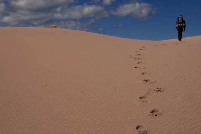 Footprints through Sandwood Bay sand dunes